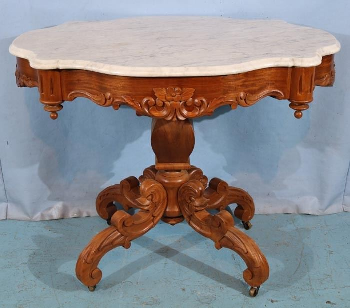 132a  Walnut Victorian turtle top center table with dolphin heads on base with white marble, 29 in. T, 38 in. W, 26 in. D.