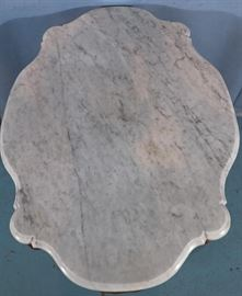 132f  Walnut Victorian turtle top center table with dolphin heads on base with white marble, 29 in. T, 38 in. W, 26 in. D.