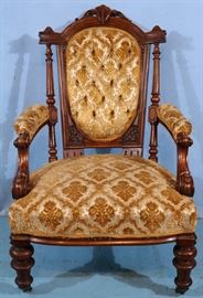 161a  Walnut Victorian arm parlor chair with carved back and black and gold upholstery, 40 in. T, 24 in. W, 22 in. D.