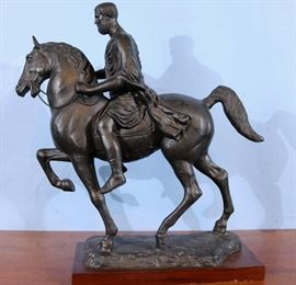 192a  Heavy cast iron horse and Roman soldier rider, 20 in. T, 13 in. W, 6 in. D.