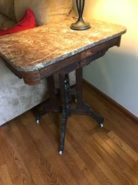 Side table on wheels and a marble top