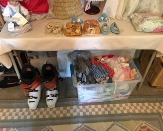 Snow boots, tub of baby clothes