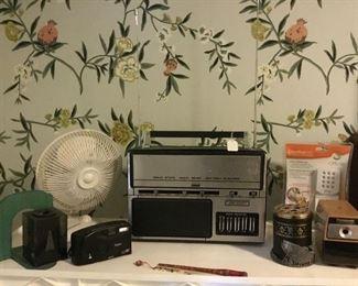 Fan,pencil sharpener, camera, pencil holder