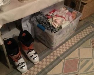 Ladies snowboots and tub of baby clothes