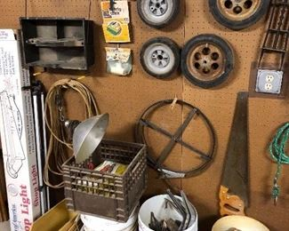 rope bucket, steel tape rooter, plastic parts bins, 4' shop bulbs, tool caddy, hand saw