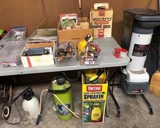 Several chemical sprayers, wood chipper, airless paint gun like new, misc elec parts, plumbing parts, vintage pickup radio, garden hand tools