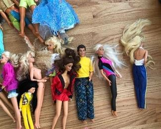Vintage Barbie and Ken dolls with clothes
