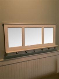 61. Mirrored Wall Shelf