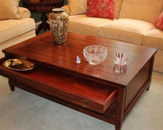 Large Wood Coffee Table with Three Drawers on Each Side by Safaavieh with Decorative Vase and Bowls