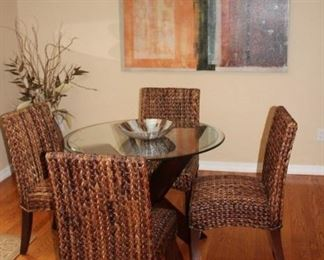 Small Round Table with Glass Top and Woven Rattan Chairs
