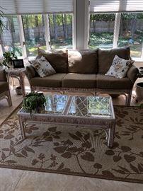 Very nice wicker sofa, chairs and table with very nice sisal rug