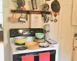 GE electric stove, hanging pot rack,  & kitchen collectibles