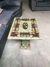There are 2 of these floral art Italian marble end tables
