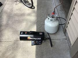 Mr Heater propane heater with half full propane tank.