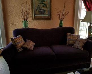 Purple velvet fringed sofa
