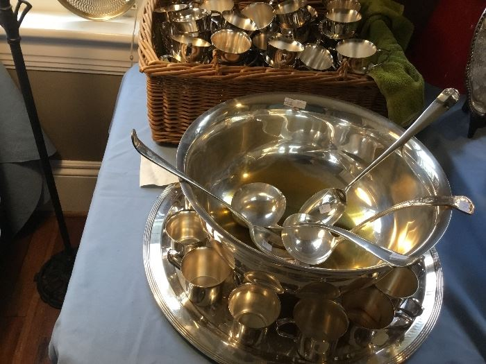 A caterer's dream: a silver plate punch bowl, extra ladles and enough handled punch cups for a plethora of guests!