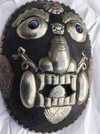 Tibetan carved wooden mask with silver mounts