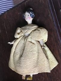 Antique carved articulated doll