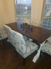 Handmade Farm house table with six chairs.