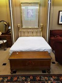 Brass queen bed and cedar chest.