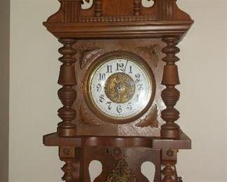 Open swinger antique German wall clock