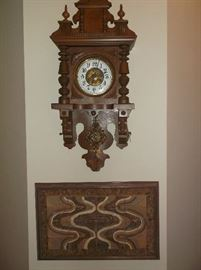 Antique wall clock and pottery wall hanging