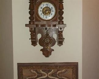 Antique  German wall clock and pottery wall hanging