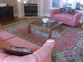 Large rug and glass top coffee table