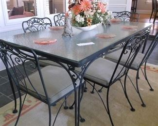 Glass top wrought iron table and six chairs