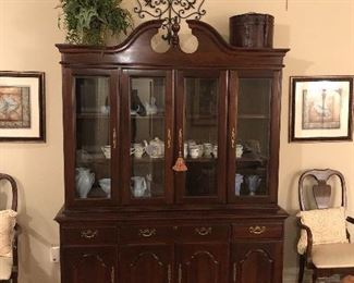 Lighted china cabinet with glass doors and bottom storage