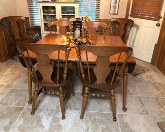 Early American style drop leaf dining table with chairs