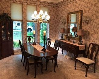 Dining set including oval table with one leaf, six dining chairs, sideboard server, and matching corner hutch