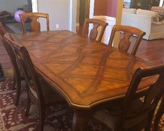 Country French dining table with one leaf, inlaid parquet top w/ six upholstered dining chairs