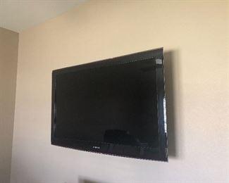 Wall-mounted flatscreen TV