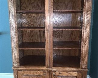 Two piece Oak bookcase with adjustable shelves, bottom storage