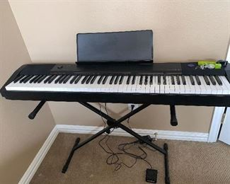 Keyboard piano on stand