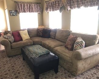L-shaped sectional sofa, large area rug, large tufted ottoman coffee table