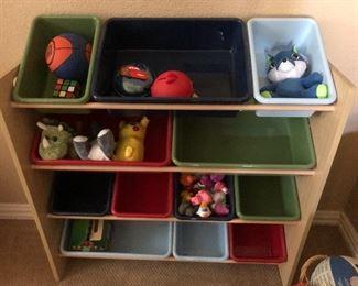 Toy storage bins on stand