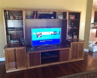 Three-piece solid wood entertainment center with bookcase shelving and bottom storage, Samsung Curved Flat Screen 4K, PlayStation Call of Duty Special Edition