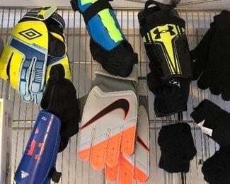 Nike, Under Armour, Adidas and Umbro sport equipment.