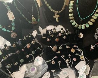 Sterling silver jewelry with turquoise, precious stones, and semi precious stones