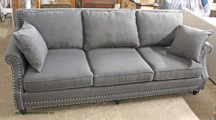NEW Contemporary Grey Upholstered Sofa with Throw Pillows  Located Inside – Auction Estimate $300-$600