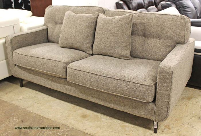 """NEW """"Ashley Furniture"""" Upholstered Contemporary Sofa with Decorator Throw Pillows (Model MAWKDO)  Auction Estimate $300-$600 – Located Inside"""