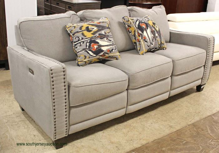 NEW Contemporary Upholstered Tacked Sofa with Power Recliners and USB Ports on Both Side  Auction Estimate $400-$800 – Located Inside