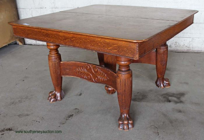 ANTIQUE Oak Paw Foot Square Oak Table with 5 Leaves  Auction Estimate $200-$400 – Located Dock