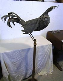 Large iron rooster sculpture, signed by artist Doug Makemson, 1990.  Stand about 5 ft. tall.