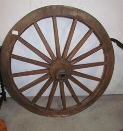 Large cart wheel, in good condition.