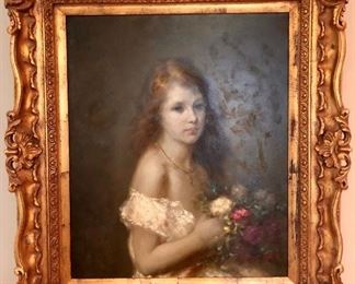 Beautifully framed oil painting of girl holding flowers