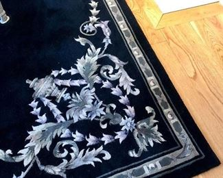 Black room rug with silver and white design