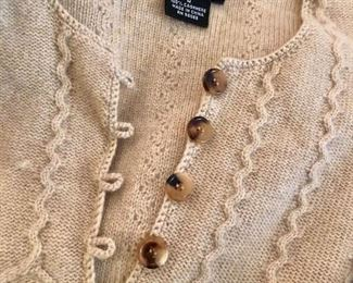 We have some beautiful clothing at this sale as well - cashmere sweater featured here!
